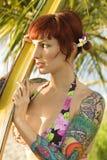 Tattooed woman in bikini. stock images