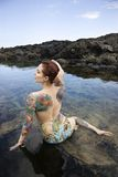 Tattooed woman in bikini. Royalty Free Stock Image