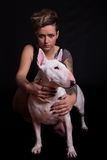 Tattooed Woman and bull terrier Stock Photos