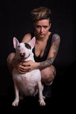 Tattooed Woman and bull terrier Stock Images