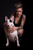 Tattooed Woman and bull terrier Royalty Free Stock Image