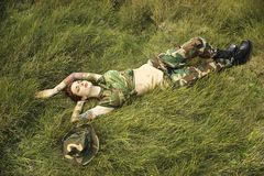 Tattooed woman in camouflage. Royalty Free Stock Images