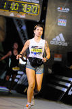 Tattooed Woman Finishing Marathon Race Stock Image