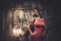 Free Tattooed Woman In Spooky Interior Stock Images - 46084294