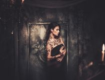 Free Tattooed Woman In Spooky Interior Royalty Free Stock Photos - 48214788