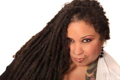 Tattooed woman  with piercings and dreadlocks Royalty Free Stock Photos