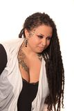 Tattooed woman  with piercings and dreadlocks Stock Images