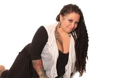 Tattooed woman  with piercings and dreadlocks Stock Photos