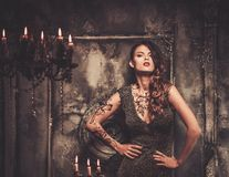 Tattooed woman  in spooky interior Stock Photos