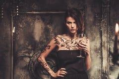 Tattooed woman in spooky interior. Tattooed beautiful woman in old spooky interior Royalty Free Stock Photo