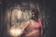 Tattooed woman in spooky interior Stock Images