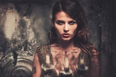 Tattooed woman in spooky interior Royalty Free Stock Image