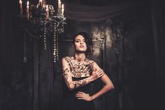 Tattooed woman in spooky interior Royalty Free Stock Photos