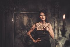 Tattooed woman in spooky interior Royalty Free Stock Photography