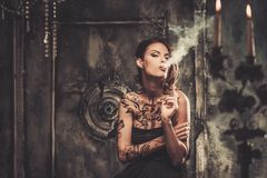 Tattooed woman  in spooky interior Royalty Free Stock Photo
