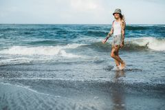Tattooed woman walking at beach Royalty Free Stock Image