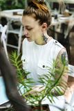 Tattooed woman working in outdoors stock image