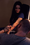 Tattooer makes scetch. Tattooer is drawing scetch on the woman`s hand using spesial marker Stock Photo