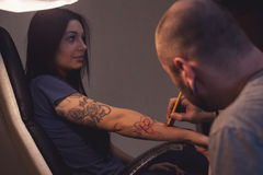 Tattooer makes scetch Stock Photos
