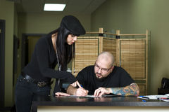 Tattooer preparing tattoo for client. In tattoo shop Royalty Free Stock Image