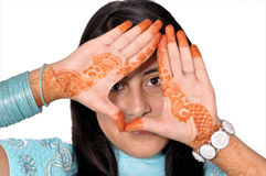 Tattooing girl hands on her  face Stock Photos