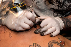 Tattooing process Royalty Free Stock Photos