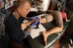 Tattooist Stock Photo