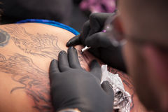 Tattooist Draws Outline Royalty Free Stock Photo