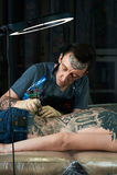 Tattooist in studio Royalty Free Stock Photos
