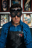 Tattooist in welder glasses and leather apron Stock Images