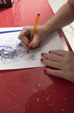 Tattooist woman tracing contours of sketch drawing Royalty Free Stock Photo