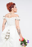 Tattoos Bride portrait. Tattooed bride seen from the back, posing in studio and looking away royalty free stock images