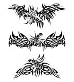 Tattoos dragons. Three tattoos with mythic dragons Stock Images