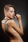 Tattoos and piercings Stock Image