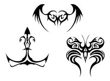 Tattoos set. Black and white vector tattoos set Royalty Free Illustration