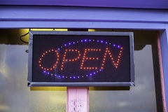 Tatty old seaside neon open sign Stock Photography