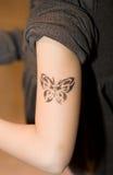 Tatuagem do miúdo Fotos de Stock
