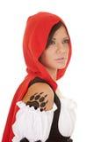 Tatuagem vermelha da garra da capa de equitação da mulher fotos de stock
