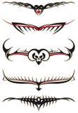 Tatuagens tribais ajustados vermelhos Fotografia de Stock Royalty Free
