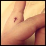 Tatuaje cruzado Imagenes de archivo