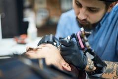 Tatuaje en cara Fotos de archivo