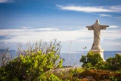 Tatue de Jesus Christ em Garajau em Funchal com vista regional surpreendente, Madeira Fotos de Stock Royalty Free