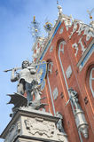 Riga, Latvia - August 10, 2014 - Saint George battles to dragon, Statue of the knight Roland with sword defeating a dragon in fron Royalty Free Stock Photo