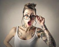 Tatuerad flicka Arkivbild