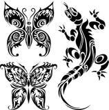 Tatueringteckningar av fjärilar och ödlan Royaltyfria Bilder