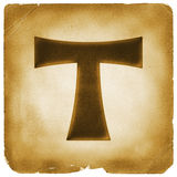 Tau cross symbol on old paper Stock Photo