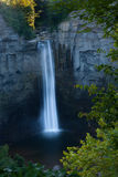 Taughannock water fall. Hide in the tree Royalty Free Stock Photography