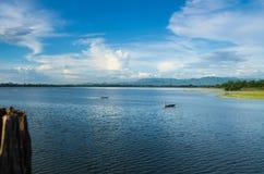 Taung Tha Man lake at U-bein bridge with sampans Stock Photos