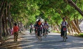 Women biking on street stock photos