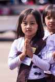 Burmese girl wearing a white dress to the temple to pray on the Buddha day stock images